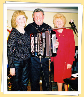 johnny barrett with two marys on  stage in tipparary